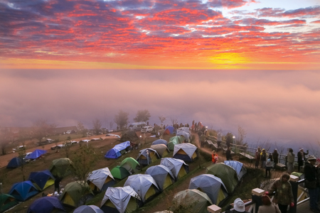january sunrise: PHETCHABUN,THAILAND - JANUARY 15, 2015: Camping on the big mountain in Phu Tub berk of Thailand as tourist style with sunrise sky Editorial