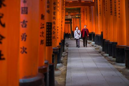 wooden trail sign: KYOTO, JAPAN - MARCH 24, 2016 : Torii gates in Fushimi Inari Shrine, Kyoto, Japan