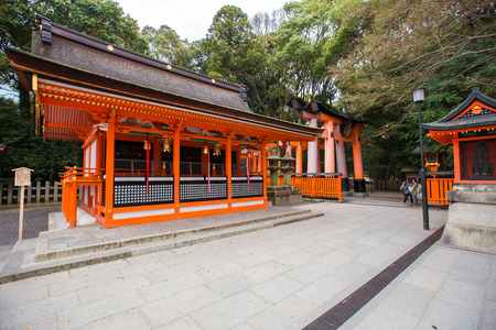 wooden trail sign: Torii gates in Fushimi Inari Shrine, Kyoto, Japan Editorial