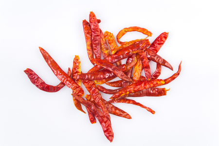 capsaicin: dried chili peppers on white background