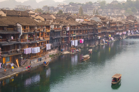 tentative: HUNAN, CHINA - OCT 22 : Old houses in Fenghuang county on Oct 22, 2013 in Hunan, China. The ancient town of Fenghuang was added to the UNESCO World Heritage Tentative List in the Cultural category.