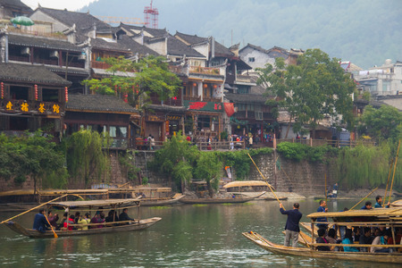 house float on water: HUNAN, CHINA - OCT 22 : Old houses in Fenghuang county on Oct 22, 2013 in Hunan, China. The ancient town of Fenghuang was added to the UNESCO World Heritage Tentative List in the Cultural category.