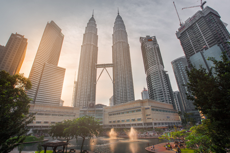twin tower: KUALA LUMPUR, MALAYSIA - AUGUST 20, 2016 : The Petronas Twin Towers in Kuala Lumpur, Malaysia are the worlds tallest twin tower. The skyscraper height is 451.9m Editorial