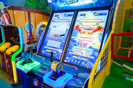 entertaining area: BANGKOK, THAILAND - OCTOBER 1, 2016 : game machines at the Hero city at the MBK Center, a shopping mall. Bangkok is one of the worlds top tourist destination cities.
