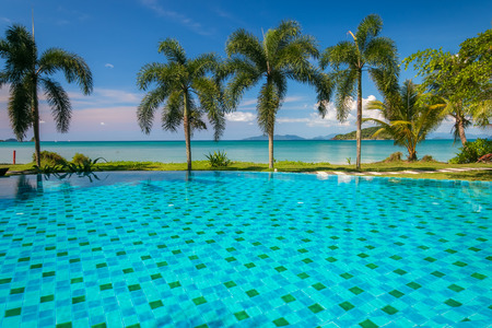 inground: Tropical beach with coconut palms and swimming pool