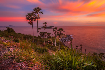 Promthep Cape is a mountain of rock that extends into the sea view point sunset in Phuket, Thailand