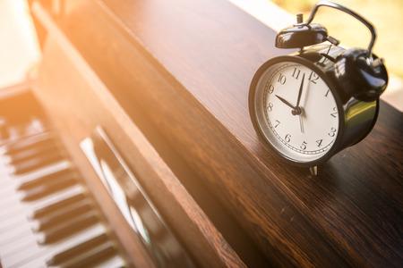 alarm clock on piano