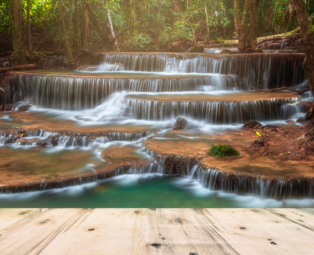 Waterfall in Deep Forest of Huay Mae Khamin Waterfall and Wood Pier Stock Photo
