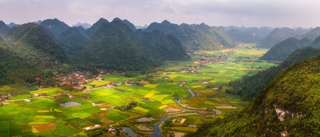 plowing: Rice field in valley around with mountain panorama view in Bac Son valley, Lang Son, Vietnam Stock Photo