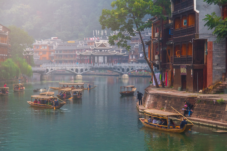 HUNAN, CHINA - OCT 22 : Old houses in Fenghuang county on Oct 22, 2013 in Hunan, China. The ancient town of Fenghuang was added to the UNESCO World Heritage Tentative List in the Cultural category.