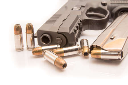 9mm ammo: close-up on 9mm ammo with a handgun.