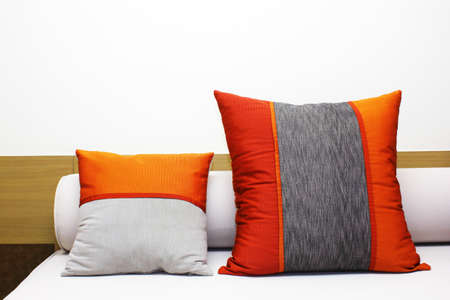 r furniture: bed and two colorful pillow