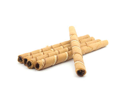 Wafer roll sticks cream rolls over a white background  Stock Photo