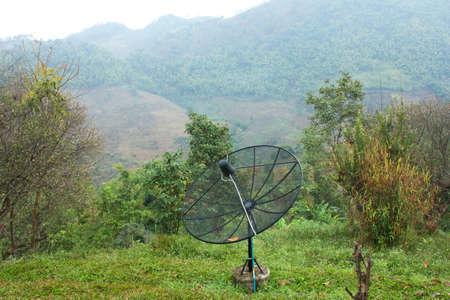 Black antenna communication satellite dish and mountain Stock Photo - 17844258