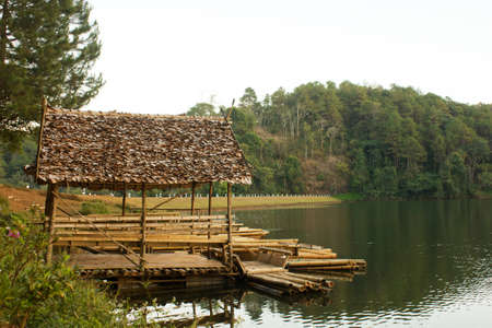 Bamboo Hut On The Lake with Moutain photo