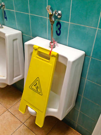 Yellow sign that alerts for wet floor.  photo