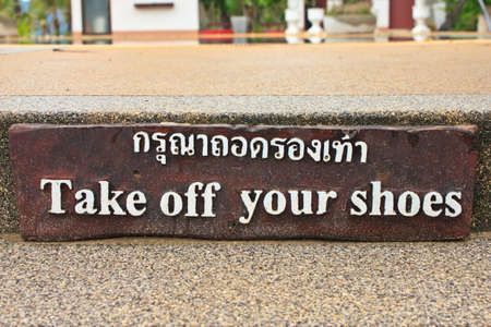 thai language:  take off your shoes  sign and Thai language