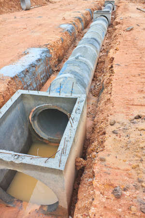 The Concrete drainage tank on construction site photo