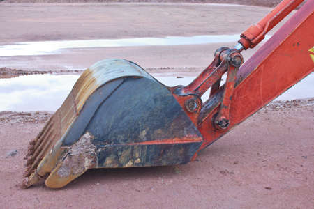 The Backhoe Claw bucket with orange arm  photo