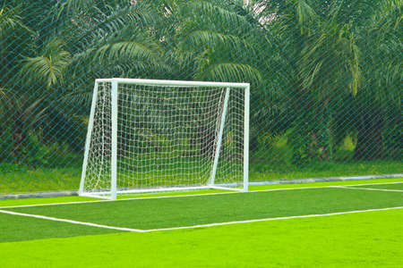 goalline: A soccer net with shot in bright sunlight with trees in the background   Stock Photo