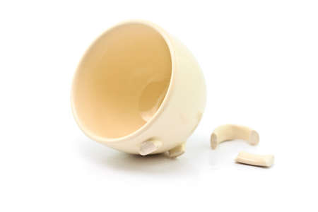 Broken white cup on a white background photo