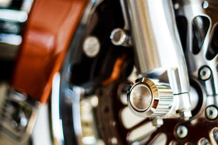 secure brake: Front wheel of motorcycle, large break disc, black mudguard  Stock Photo