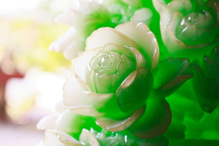 The carving flower made from green jade Stock Photo
