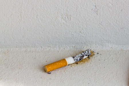 End of smoking, stub on white concrete photo