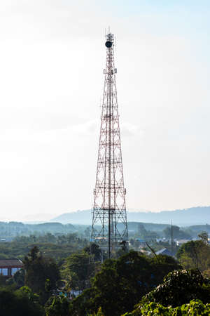 transmitting: A telecommunications tower transmitting signals in the town