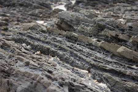 Stratified rocks in a cliff face , rock layer Stock Photo