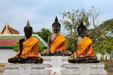 Three old sitting Buddha in temple , Thailand.  photo