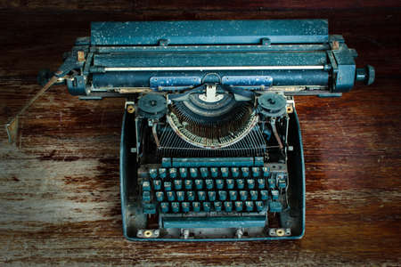 typewrite: The old typewrite on the wooden table