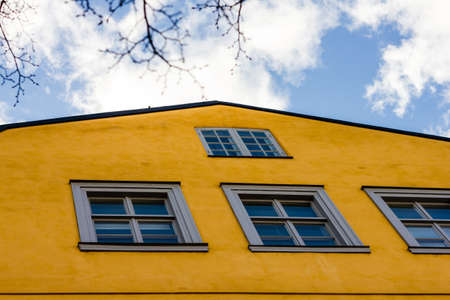 oldstyle: Old-style yellow wall of a building with windows