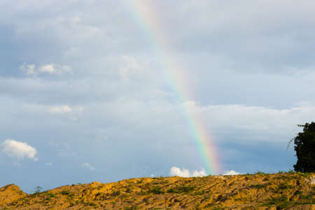 end of rainbow: End of rainbow with the blue sky Stock Photo