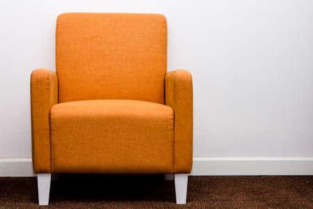 Orange sofa furniture on white wall background Standard-Bild