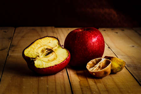shrunken: Rot and withered Fruits,On wooden plate