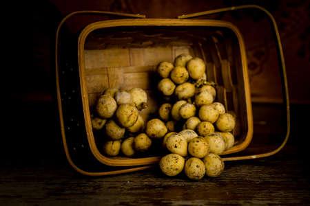 threshing: Wollongong in threshing basket on wooden table