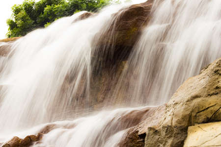 peace risk: photography of beautiful waterfall on the rocks