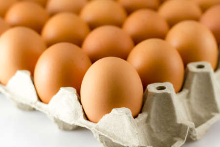 Close up of Eggs in paper tray Stock Photo