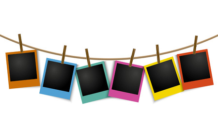 Empty colorful photo frames hanging on rope with pin