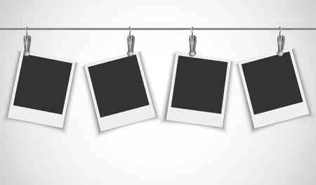Blank photo frame hanging on a wire rope with metallic clip