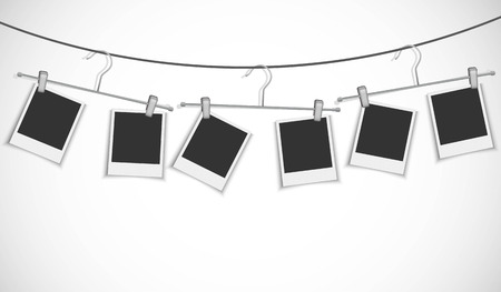 clothes hanging: Blank photo frame hanging on a rope with clothes hanger