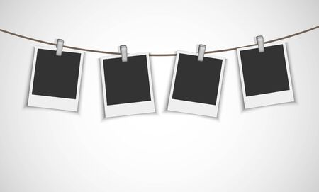 clothespin and rope: Blank photo frames hanging on the metallic clip