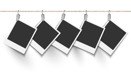 Blank photo frame hanging on metallic clip