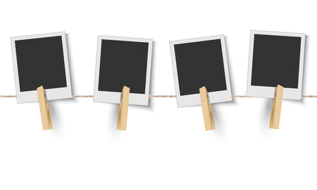Blank instant photo frames hanging on the clothesline
