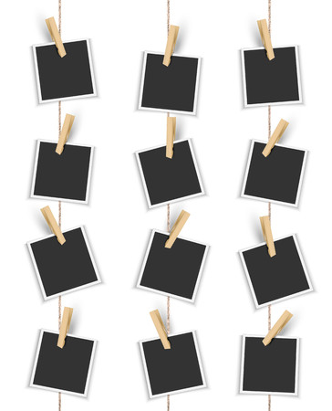 Blank photo frames hanging vertically with clothespin