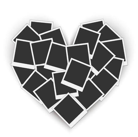 Piled blank photo frames in a heart shape