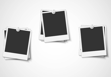 Blank piled photo frame pinned on wall