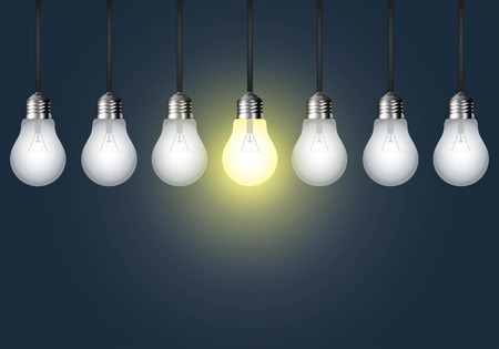 Hanging light bulb on a dark background. Idea concept.