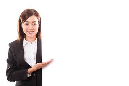 Smiling young business woman showing blank board while